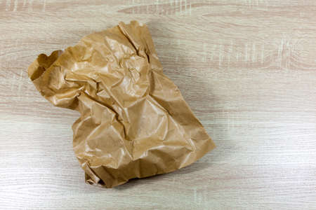Crinkled and creased brown paper bag - copy space provided