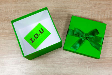 I.O.U message in an empty gift box