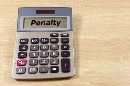 Calculator with the word 'Penalty' - copy space provided