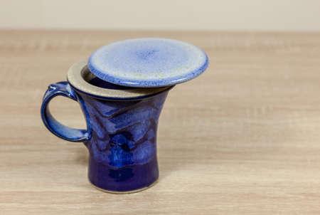 Blue ceramic cup with a lid - copy space provided Reklamní fotografie