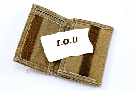 IOU note on top of an old and worn fabric wallet