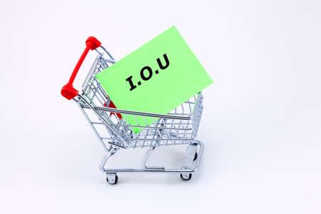 Money Lending Concept - Shopping trolley carrying an IOU note