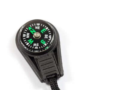 Close up of a small pocket compass on a white background - copy space provided Reklamní fotografie