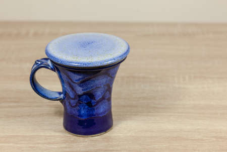Blue patterned ceramic cup with a lid - copy space provided