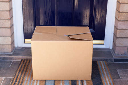 Home Delivery - Box left on front doorstep of house