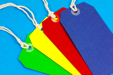 Four brightly coloured labels on a blue background
