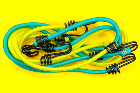 New bungee cords in yellow and green Archivio Fotografico