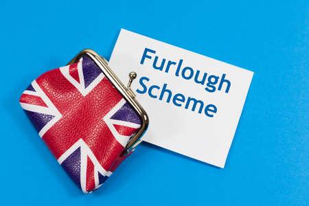Furlough Scheme Cost Concept - with union jack purse alongside 'Furlough Scheme' message Archivio Fotografico