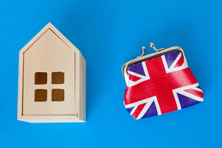 UK Housing Market Concept - with wooden house and union jack purse