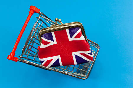UK Spending Concept - with union jack purse in a shopping trolley - with copy space