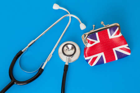UK Hospital Funding Concept with union jack purse and dual head stethoscope
