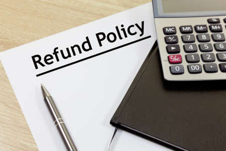 Refund Policy Concept - with document and calculator