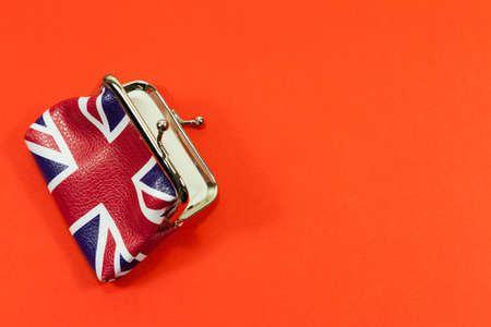 Open union jack purse on a red background - with copy space