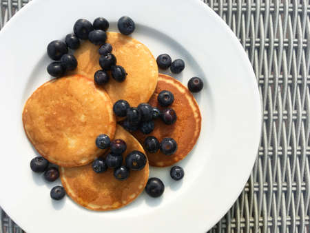 Breakfast of pancakes with blueberries - top down view