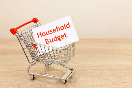 Shopping trolley carrying a message which reads 'Household Budget'