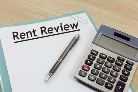 Rent review concept - with document, calculator and pen