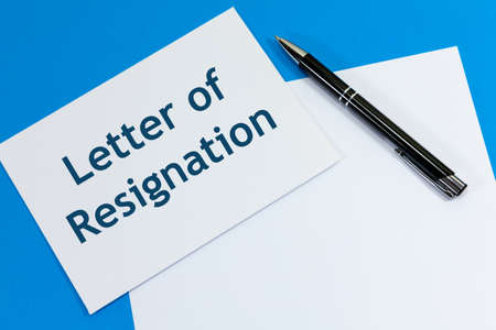 Envelope with the words 'Letter of Resignation' alongside pen and paper