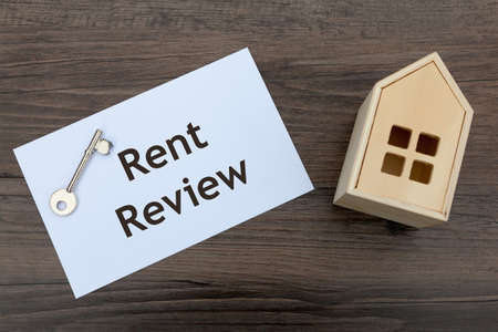 Rent Review Concept - with envelope, key and model house Archivio Fotografico