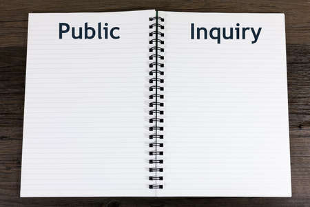 Public Inquiry Concept - book with open blank pages and the heading 'Public Inquiry' Archivio Fotografico