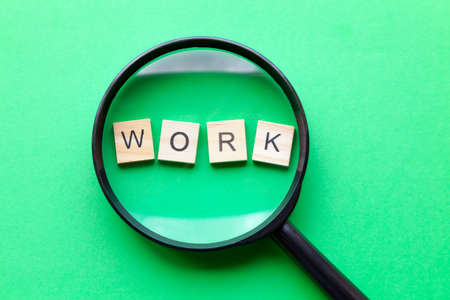 The word 'work' viewed under a magnifying glass