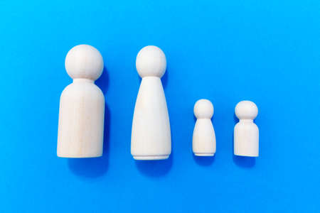 Miniature wooden figures representing a family unit