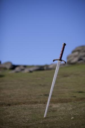 arthur: Sword with moorland landscape
