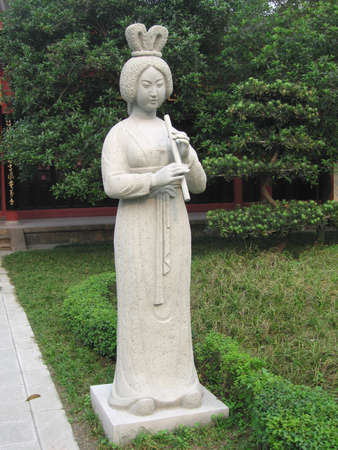 aerophone: a sculpture of a china tang dynasty woman Stock Photo