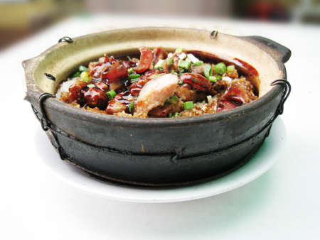 a bowl of clay pot chicken rice, asian style food
