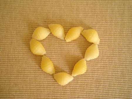 top view of a love shape made by pasta shell Stock Photo - 3217297