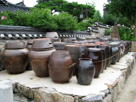 a lot of kimchi pot at the backyard of a heritage  in korea