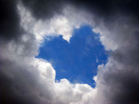 blue love shape sky around with heavy clouds photo