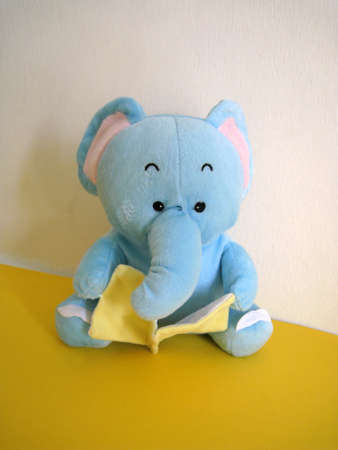 soft toy: a elephant soft toy reading book Stock Photo