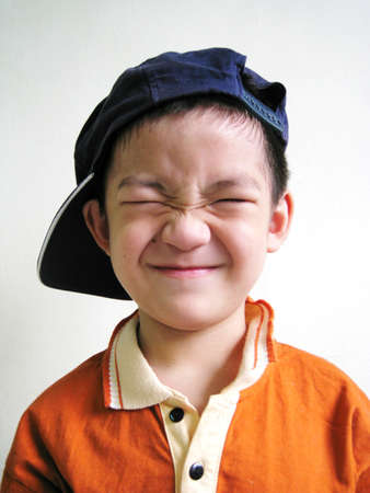 clse up: A close up for a asian boy with face expression