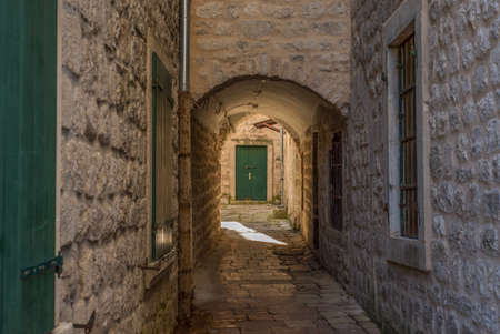The narrow street full of doors and windows in the old town - Kotor, Montenegro