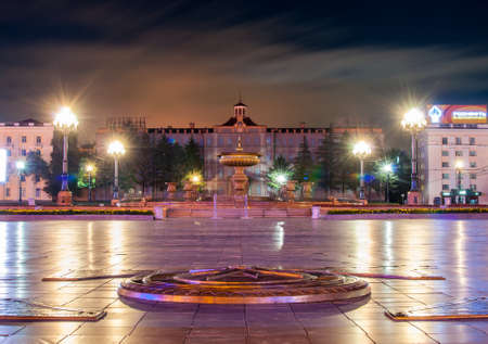 kilometer: The main square of Khabarovsk - Lenin Square at night - in the foreground zero kilometer, behind it the main fountain and historic building