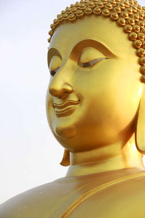 buddist: gold buddha with smiling face , Thailand Stock Photo