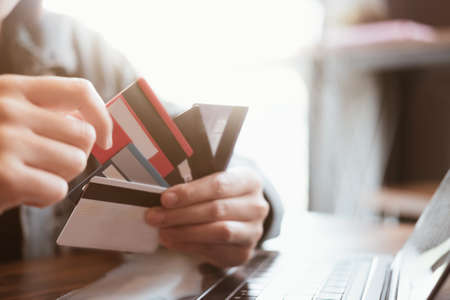 Close up.Hands holding credit card and using laptop. Online shopping Фото со стока