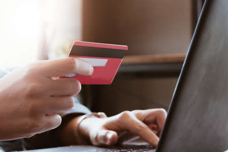 woman asian making online payment on laptop computer with credit card for shopping on onlines retail shop at home Фото со стока