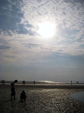 Silhouetted people on the beach photo