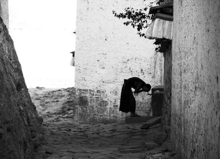 Tibet monk washing face