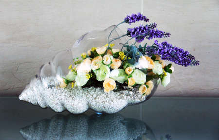 pepples: Decorative shell vase with flowers Stock Photo