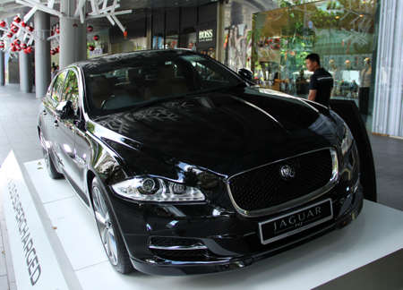 Jaguar car in front of shopping mall