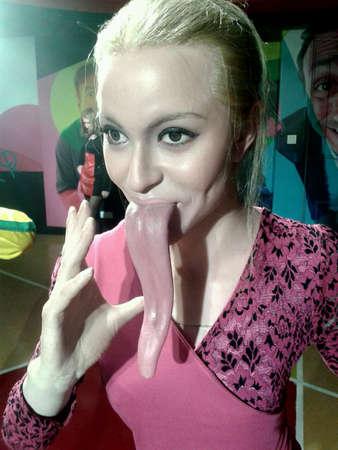 longest: Longest tongue woman at wax museum