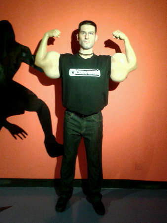 biggest: Biggest biceps man at wax museum Stock Photo