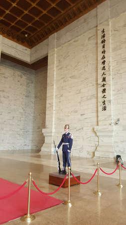 shek: Taipei, Taiwan - March 31, 2016: Soldier stand guard at the Chiang-kai Shek Memorial Hall. Editorial