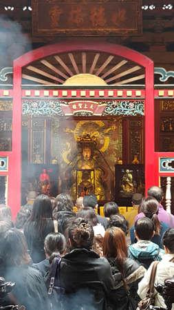 TAIPEI CITY, TAIWAN - March 31, 2016: People pray in Longshan Buddhist temple in Taipei, Taiwan
