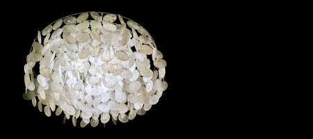 luminous chandelier hanging on a black background