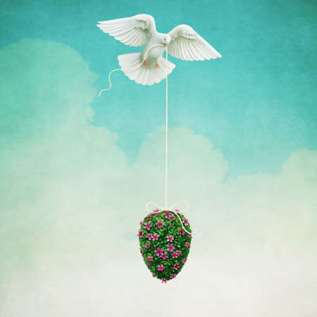 Holiday greeting card with Easter Egg from grass and flowers and Dove. Stock Photo