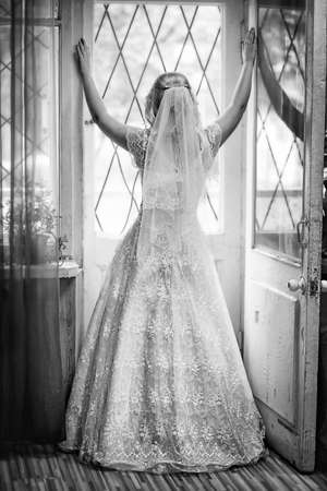 reverie: Bride at the window