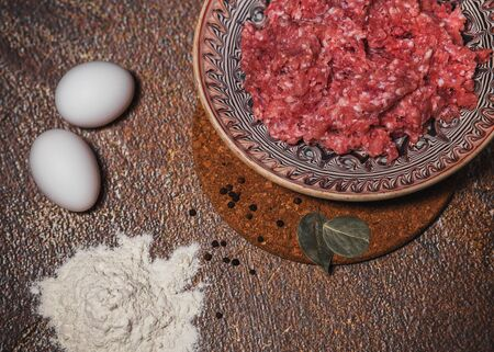 minced meat in a plate, eggs and flour. Stock Photo
